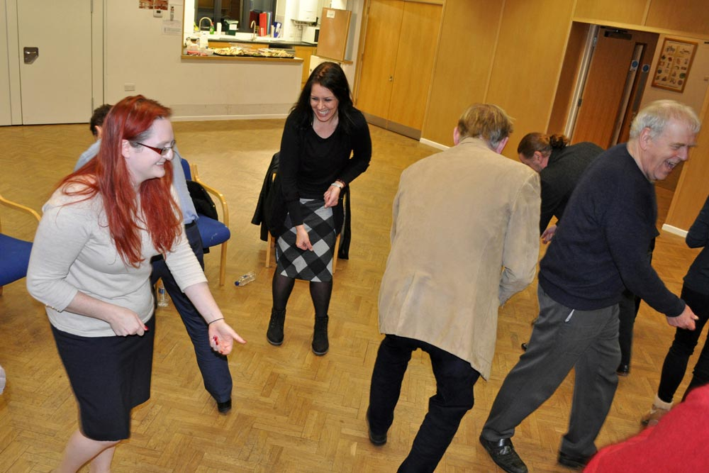 Lotte Mikkelsen of United Mind instructs Chiltern Chamber laughter yoga event