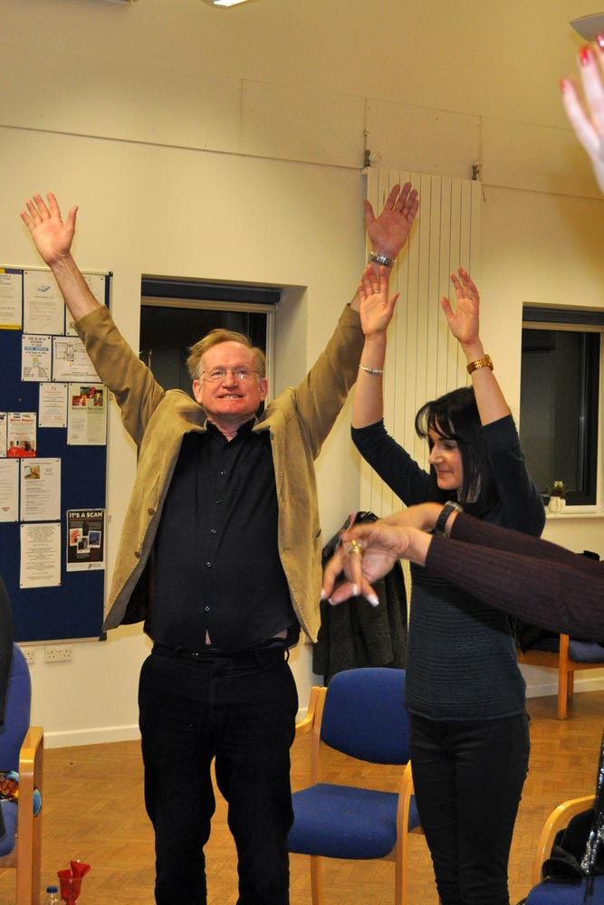 Andy Garnett reaches for the sky at Chiltern Chamber laughter yoga networking